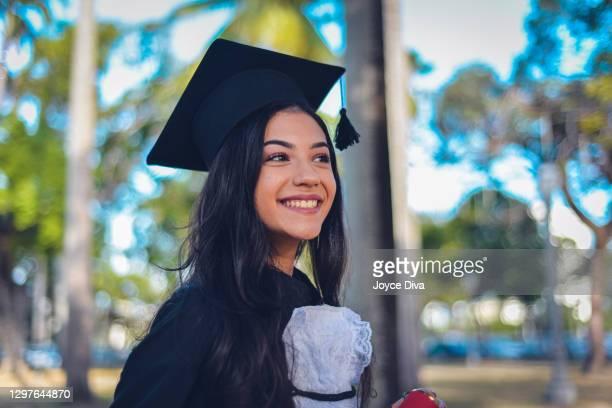 person in college or graduate school - high resolution image - formatura imagens e fotografias de stock