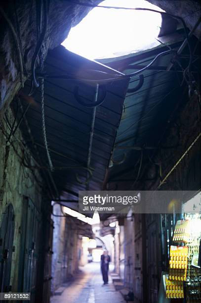 Person in covered arcade, Old City, Jerusalem, Israel