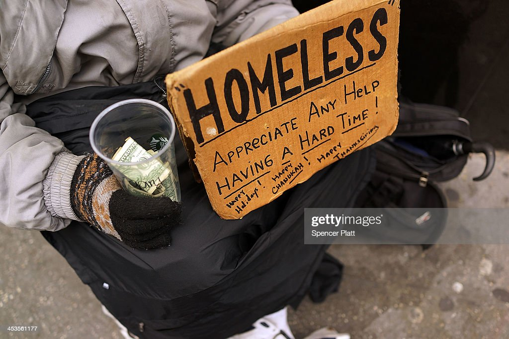 Panhandlers' Placards Show Signs Of Continued Economic Hardship : News Photo