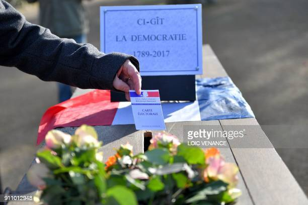 A person in favour of the transfer of the NantesAtlantique airport to NotreDamedesLandes inserts an electoral card in a coffin during a demonstration...