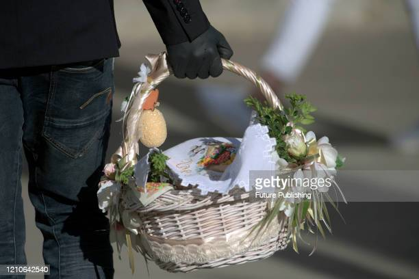Person in gloves carries an Easter basket during the quarantine, Lviv, western Ukraine. - PHOTOGRAPH BY Ukrinform / Barcroft Studios / Future...