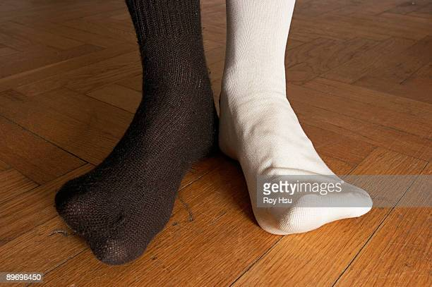 person in mismatched socks - mismatched clothes stock pictures, royalty-free photos & images
