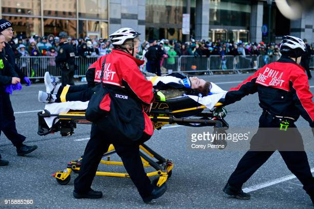 A person in need of medical attention is carted away on a stretcher during festivities on February 8 2018 in Philadelphia Pennsylvania The city...