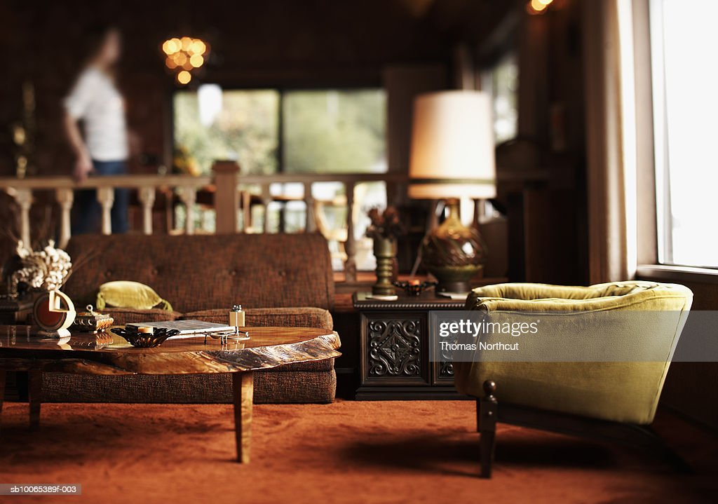 Person in room (differential focus) : Stock Photo