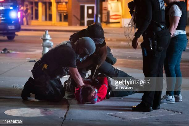 A person is arrested during protesting and rioting in Atlanta on May 29 2020 The death of George Floyd on May 25 while under police custody has...