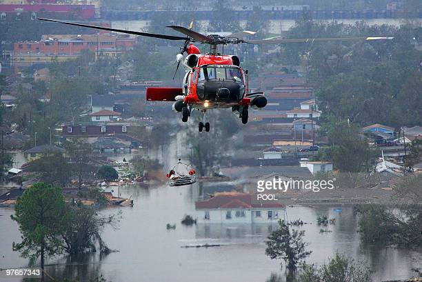 A person is lifted to safety by a Coast Guard helicopter in the aftermath of Hurricane Katrina 30 August 2005 in New Orleans Louisiana It is...