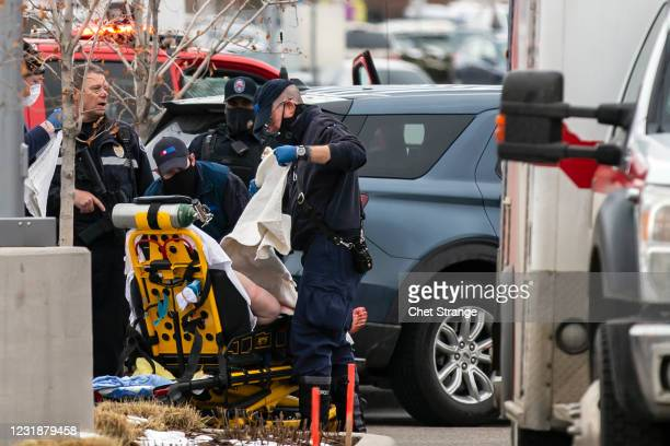Person is loaded onto a stretcher after a gunman opened fire at a King Sooper's Grocery store on March 22, 2021 in Boulder, Colorado. Dozens of...