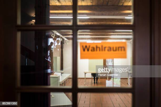 A person is pictured in a polling station on September 24 2017 in Diehsa Germany This Sunday 615 million people of Germany are called to give their...