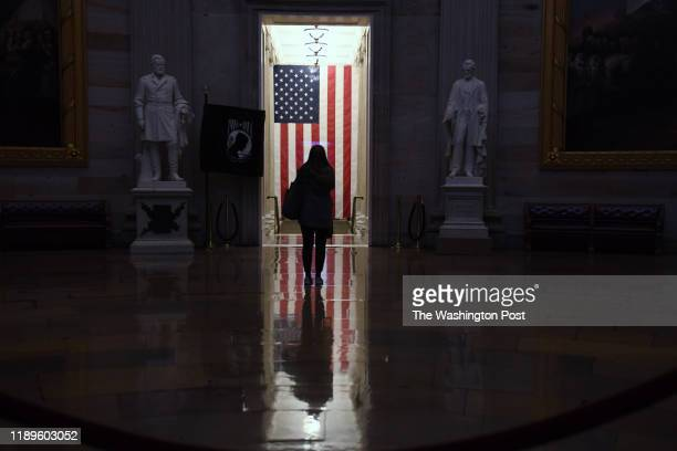 A person is seen against an American Flag inside the United States Capitol Rotunda on Wednesday December 18 2019 in Washington DC The United States...