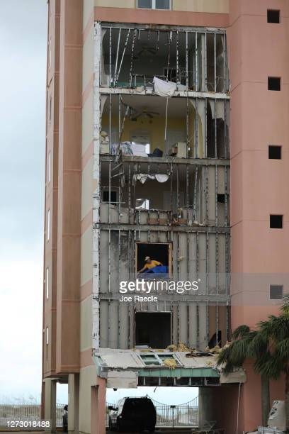 A person is seen in an apartment in the Tropic Isles complex after the outer wall was torn off when Hurricane Sally passed through the area on...