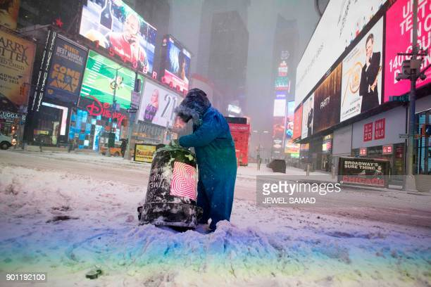 TOPSHOT A person is seen in Times Square during a winter storm in New York on January 4 2018 The US National Weather Service warned that a major...