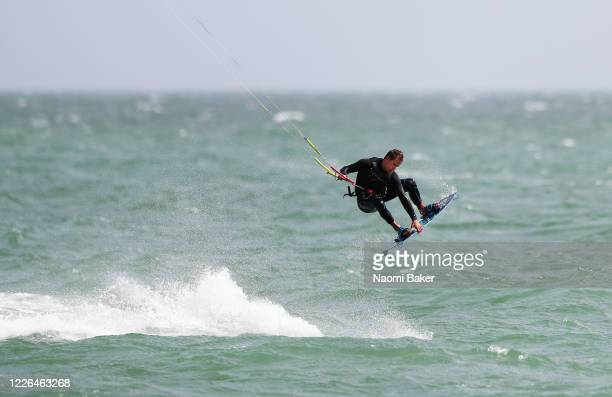 A person is seen kitesurfing at Hayling Island Beach on May 22 2020 in Hayling Island England The British government has started easing the lockdown...