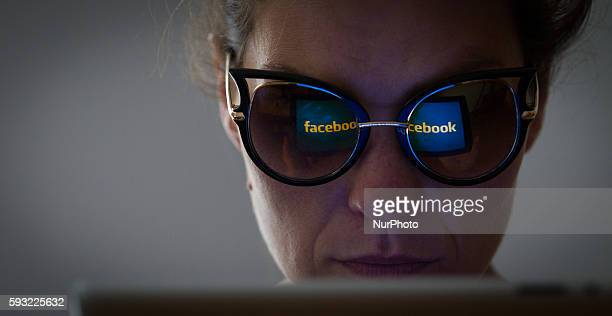 A person is seen logging on to Facebook via a browser on a tablet in Bydgoszcz Poland on August 21 2016