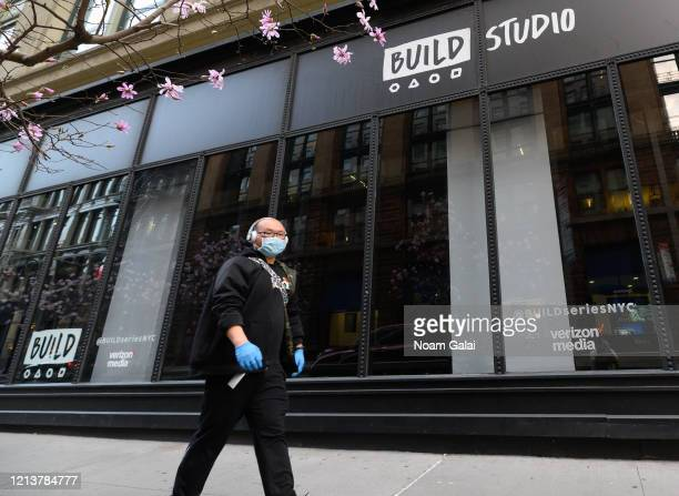 Person is seen wearing a protective face mask and gloves outside Verizon Media's Build Studio as the coronavirus continues to spread across the...