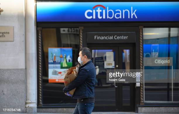 Person is seen wearing a protective face mask outside Citibank in Murray Hill as the coronavirus continues to spread across the United States on...