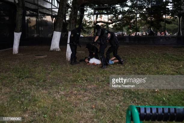 Person is taken down by riot police following yesterday's election in which a reported 3,000 protesters nationwide were detained on August 10, 2020...