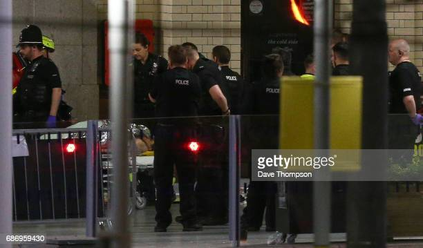 Person is wheeled away on a stretcher at Victoria Railway Station close to the Manchester Arena on May 23, 2017 in Manchester, England. An explosion...