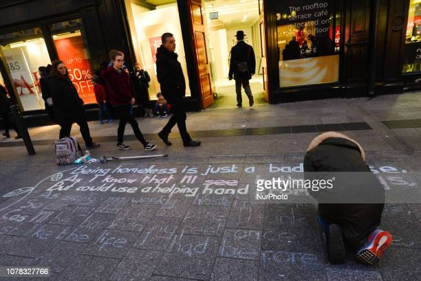 A person is writing a message on Dublin's Grafton Street quotBeing homeless is just a bad phase As I know that I'll see better days But could use a...