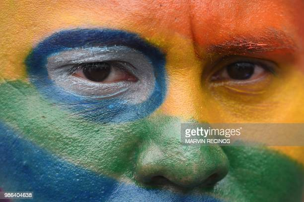 A person joins thousands of Nicaraguan antigovernment protesters including members of the Lesbian Gay Bisexual Transgender/Transsexual and Intersexed...