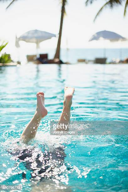 Person jumping in swimming-pool