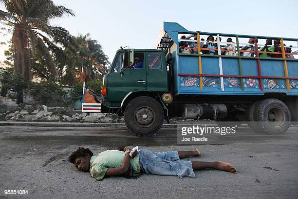 A person killed with his hands bound behind his back is seen on the street in the early morning January 18 2010 in PortauPrince Haiti No information...