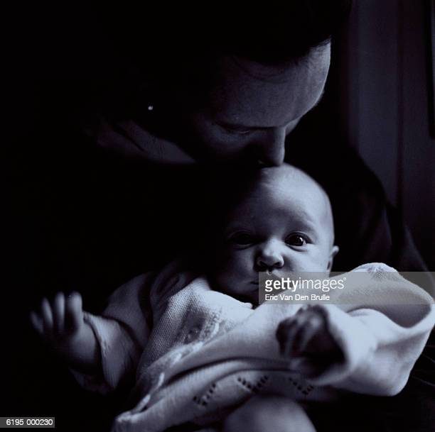 person kissing baby's head - eric van den brulle stock pictures, royalty-free photos & images