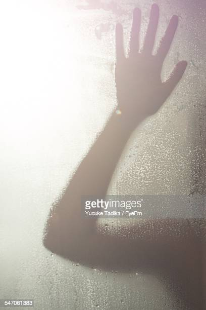 Person Leaning Against Wet Glass