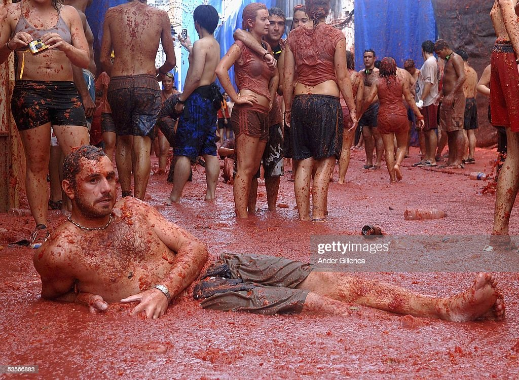 A person lies immersed in tomato juice in the 'Tomatina' on August 31, 2005 in Bunyol, Spain. The origins of the Tomatina are unknown, however fifty years on and 45,000 people flood to the region to pelt each other with over over 100.000 kilograms of Spain's finest tomatoes.