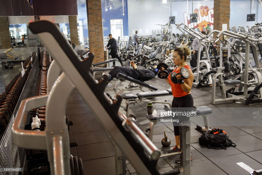 a person lifts weights at a crunch fitness gym location in burbank news photo getty images 2