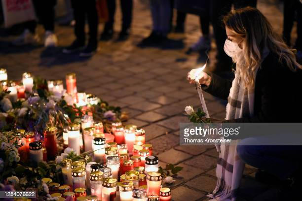 Person lights a candle at a makeshift memorial at the scene of a terror attack last Monday in which a gunman shot a number of people, on November 05,...