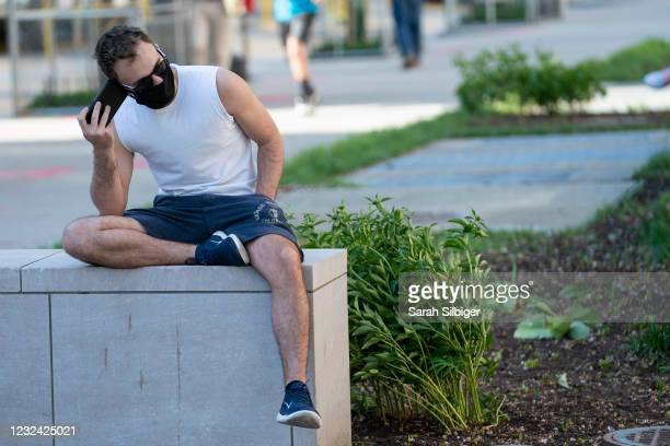 Person listens on a cell phone to the verdict of the Derek Chauvin trial at Black Lives Matter Plaza near the White House on April 20, 2021 in...