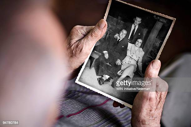 person looking at a photograph, argentina - fotografie stock-fotos und bilder
