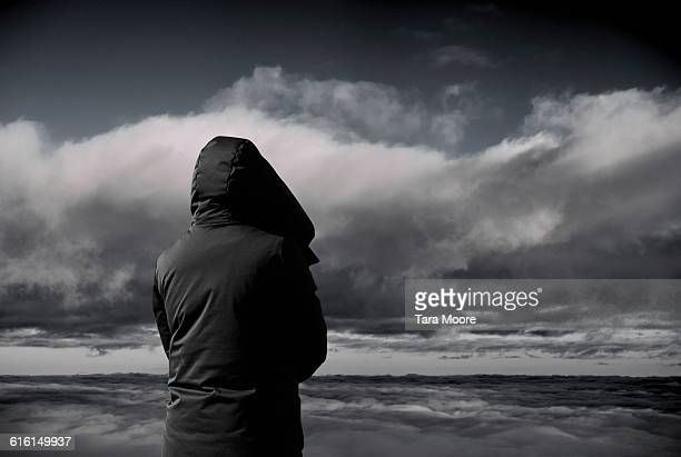 person looking at dark clouds - despair stock pictures, royalty-free photos & images