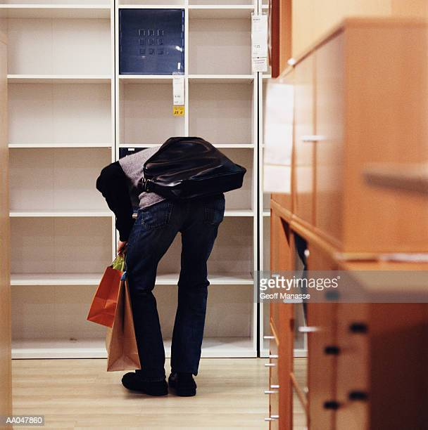person looking at furniture in store, rear view - man bending over from behind stock photos and pictures