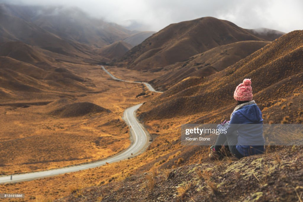 Person Looking at Mountain Road : Stock Photo