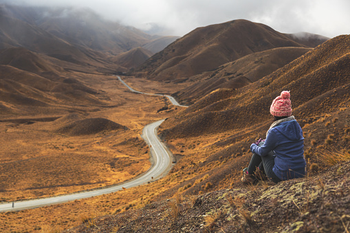 Person Looking at Mountain Road - gettyimageskorea