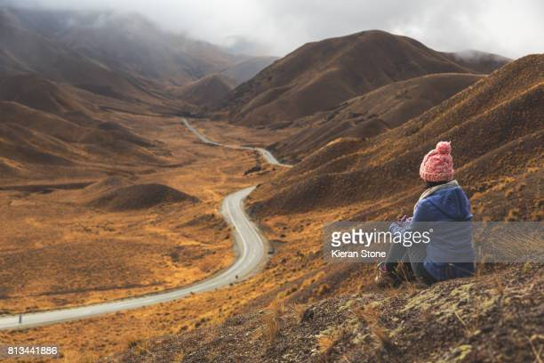 Person Looking at Mountain Road