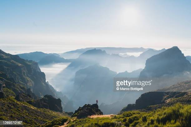 person looking at view from pico do arieiro, madeira - mountain range stock pictures, royalty-free photos & images