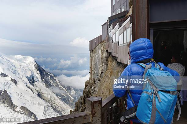 Person looking over the edge at viewpoint on Mont Blanc