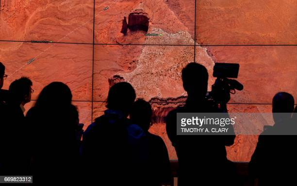 A person looks at a Google Earth map of Sentinel Mesa Monument Valley National Park UtahArizona United States on a screen as Google Earth unveils the...