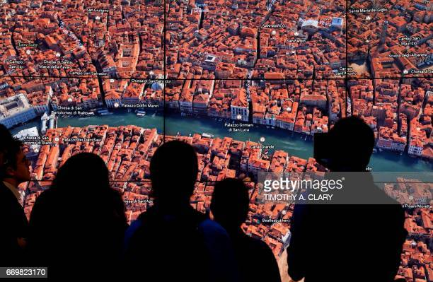 A person looks at a Google Earth map of Venice Italy on a screen as Google Earth unveils the revamped version of the application April 18 2017 at a...