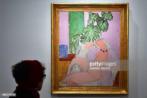 A person looks at a painting by French artist Henri Matisse during a press preview of the exhibition Matisse Arabesque on March 4 2015 at the...