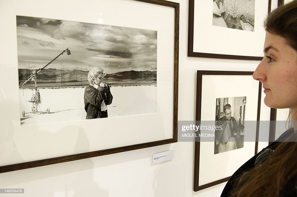 A person looks at a photograph of late US actress Marylin Monroe taken in Nevada during the shooting of the 1960 US film 'The Misfits' by late US photojournalist Eve Arnold on display during an exhibition entitled 'All About Eve' at the Arts Sensus Gallery in central London on March 1, 2012. Eve Arnold, a US photographer who took famous pictures of Marilyn Monroe among other renowned figures and was a pioneering member of the Magnum photo agency died on January 5 at the age of 99. Arnold was the first female photographer to become a full member of the storied Magnum agency in 1957. Her pictures of figures such as Monroe, Malcolm X and Marlene Dietrich were famous.
