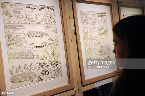 USE A person looks at Asterix cartoon sketches displayed at the Cluny Museum in Paris on October 27 during an exhibition The exhibition marking the...