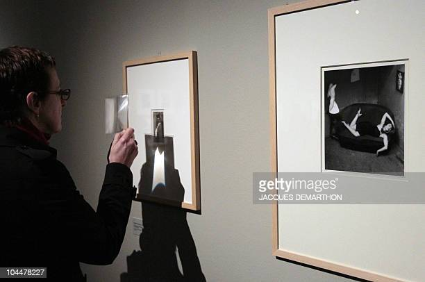 A person looks at picture by HungarianBorn US photographer Andre Kertesz 'satiric dancer' dated 1926 on September 27 2010 at the 'Jeu de Paume' in...
