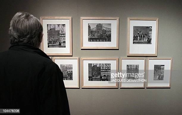 A person looks at pictures by HungarianBorn US photographer Andre Kertesz on September 27 2010 at the Jeu de Paume in Paris on the eve of the start...