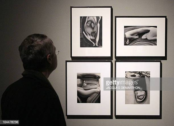 A person looks at pictures by HungarianBorn US photographer Andre Kertesz 'Distortions' dated 1933 on September 27 2010 at the 'Jeu de Paume' in...