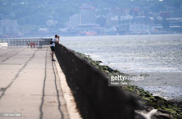 Person looks at the view from the newly reopened Governors Island as the city enters Phase 4 of re-opening following restrictions imposed to slow the...