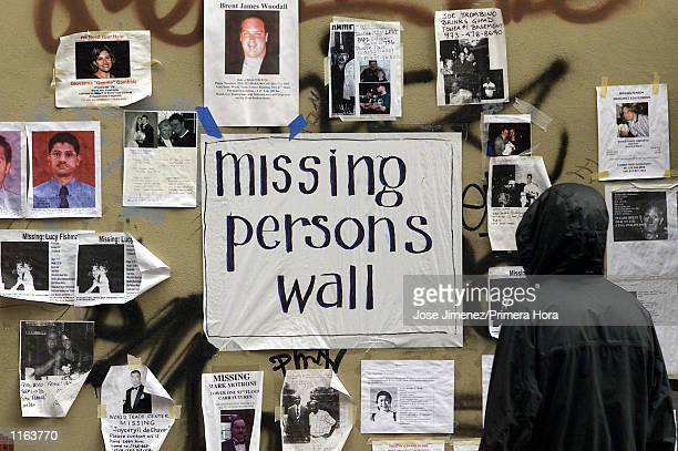 A person looks for loved ones at a missing persons board across the Saint Vincent Hospital four days after the terrorist attack at the World Trade...