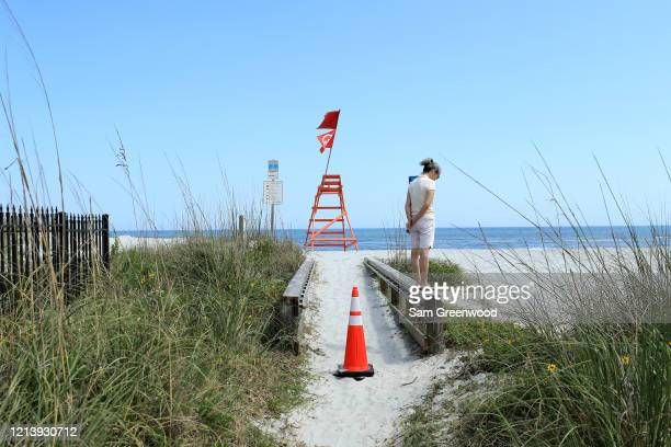 A person looks out toward Jacksonville Beach amid the coronavirus outbreak on March 21 2020 in Jacksonville Beach Florida Jacksonville Mayor Lenny...